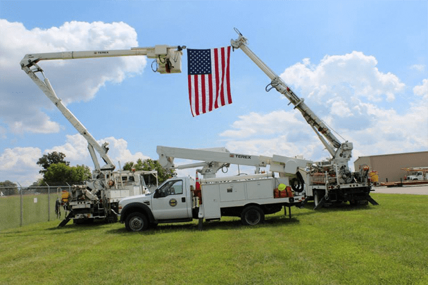 Duck River Electric vehicles holding an American Flag