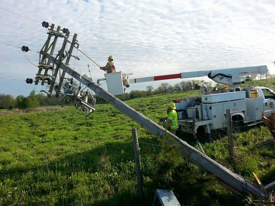 Duck River technicians fixing a fallen power line