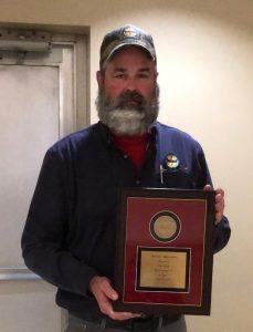 Tim Lusk receives his 30-year service award.